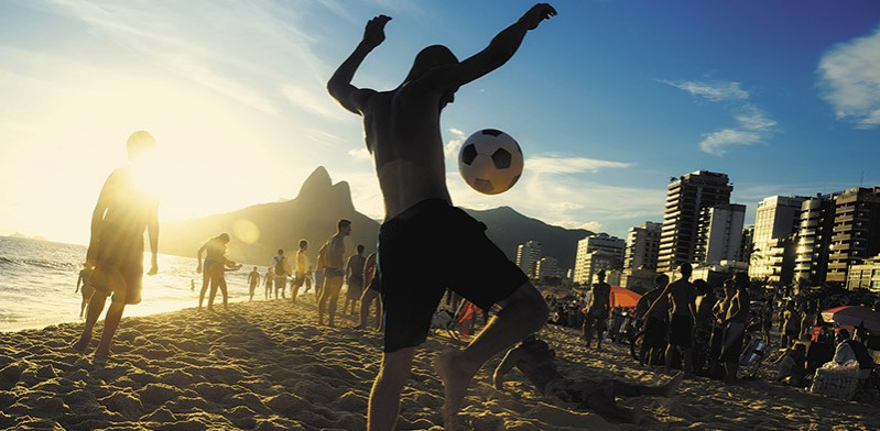 Playing football on the beach in Rio de Janeiro Brazil
