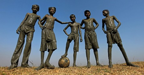 Playing football in the mud in India