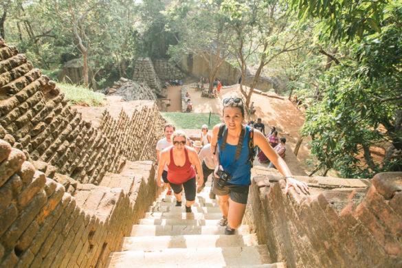 Travellers climbing steps to Sigiriya in Sri Lanka