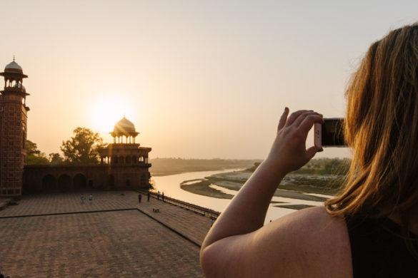 A travel blogger captures sunset
