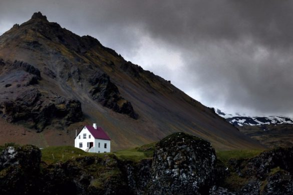 Small white house in the middle of the mountains