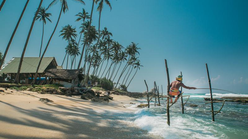 Sri Lanka beach stilt fishermen